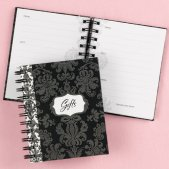 Black damask book for recording bridal shower gifts.
