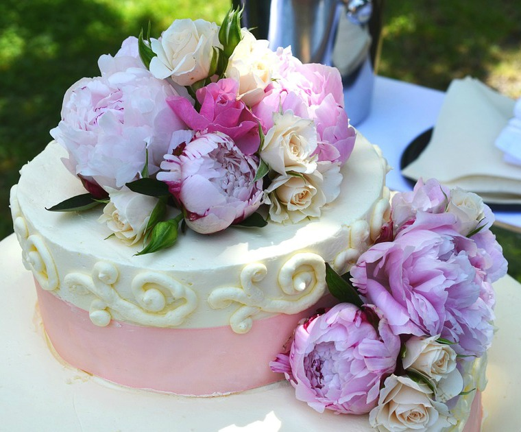 bridal shower cake with fresh flowers as topper