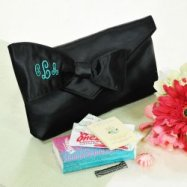Black satin clutch survival kit for bride and bridesmaids.