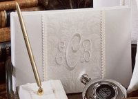 Guests can leave their best wishes for the couple in this classic monogrammed guest book.