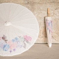 The soft floral design on this paper umbrella will add elegance to your bridal shower decor.