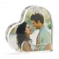 Acrylic heart cake topper that lets you insert a photo, for that personalized touch.