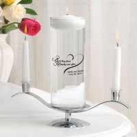 Beautiful clear glass and silver unity floating candle set for the wedding day.