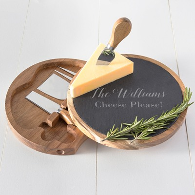 This acacia wood and slate cheese set is a unique gift for a couples shower. The slate top swivels to reveal four stored utensils. Personalize for that special touch.