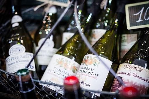 Wine bottles in a basket.