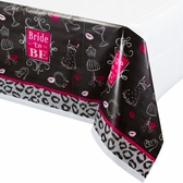 Bridal shower table cover with white top and black and pink design around the side.