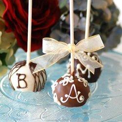 Monogrammed brownie favor pops on a stick
