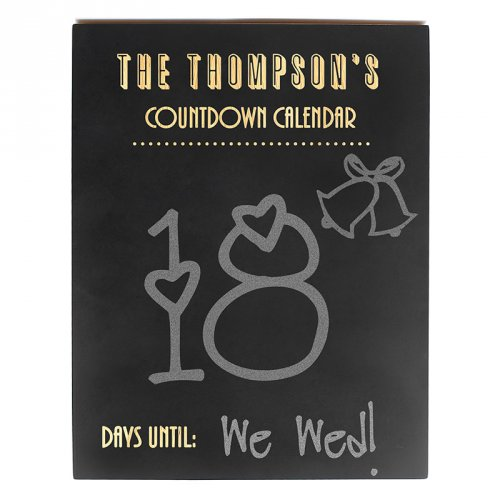 Chalkboard countdown sign to mark off days until the wedding.