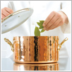 Cooking pot with glass lid for gourmet cooking.