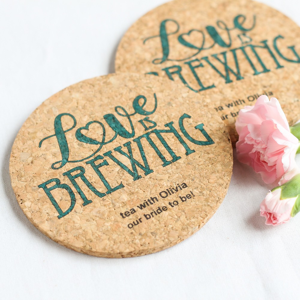 Cork coasters can be personalized with the name, date, and message for a thoughtful bridal shower favor.