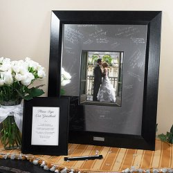 Picture frame with metal mat and engraving pen.