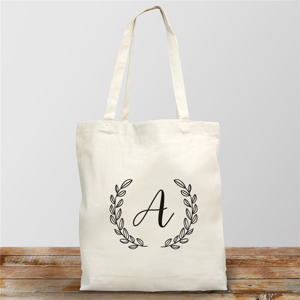 This personalized initial cotton tote can be given to the bride to be as is, or filled with something she likes. It has a leafy crown design and measures 16