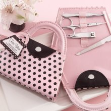 Mini pink purse with black polka dots manicure set.