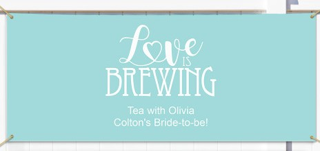 A simple blue banner with white letters for a tea themed bridal shower.