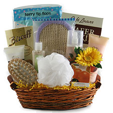 A basket filled with bath essentials to be given as a spa gift.