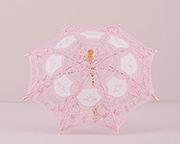 Pink lace parasol bridal shower decoration