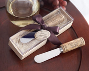 Stainless steel cheese spreader with wine cork handle.