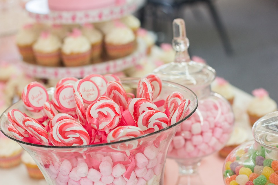 A bridal shower candy buffet can be enhanced with containers of different heights, and candy in your event colors.