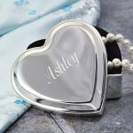 Engraveable silver jewelry box in the shape of a heart.