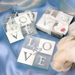 Set of four glass coasters with the word
