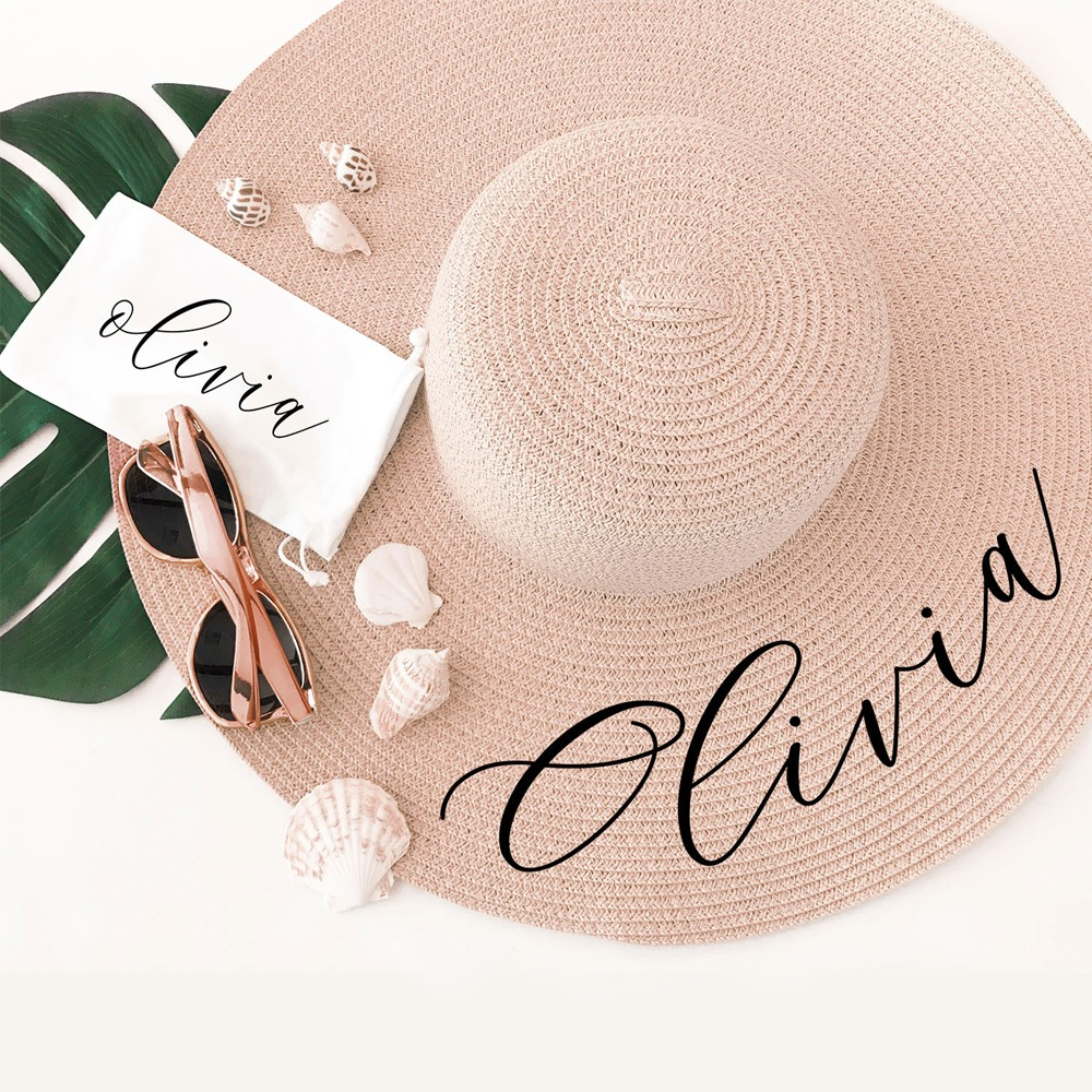 A pretty black script font turns this  straw Sun Hat into an instant style statement.
